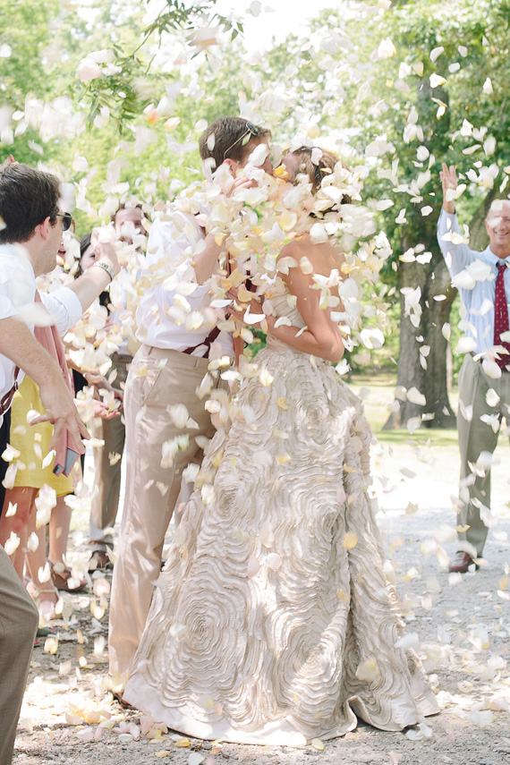 bride and groom being showered by confetti| photo by www.annabellacharles.com
