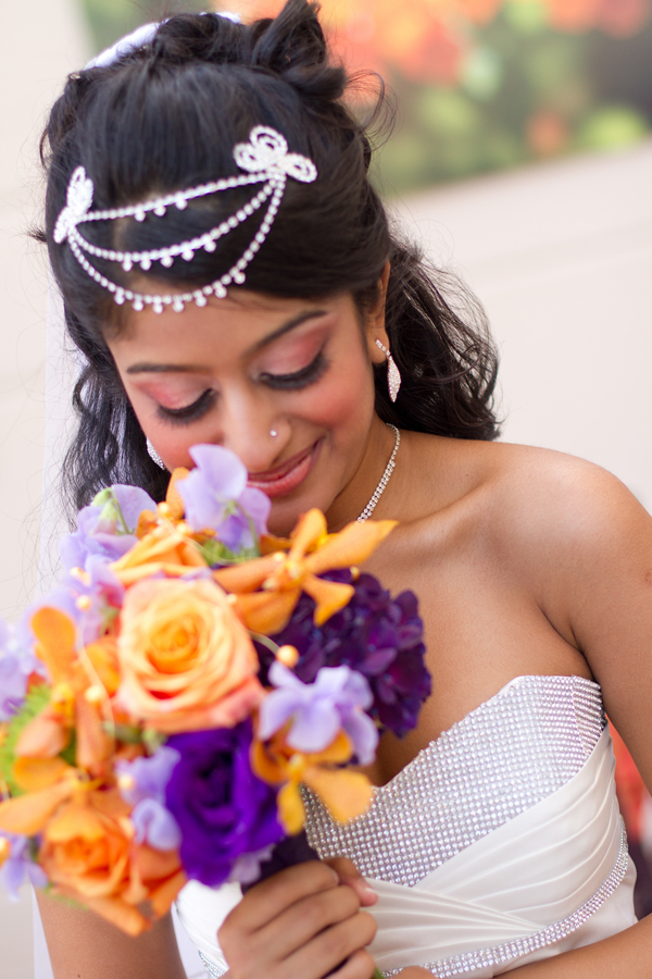 a bride and her purple and orange wedding bouquet from an Indian Fusion styled shoot | photo by Dreamcicle Studios
