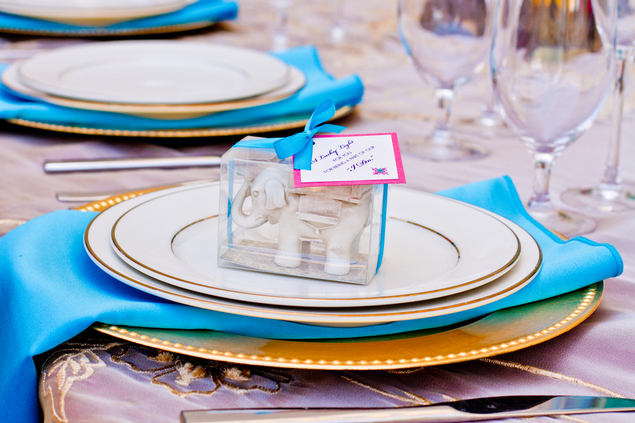 pretty turquoise place setting with an elephant favor | photo by Dreamcicle Studios #moroccan #wedding