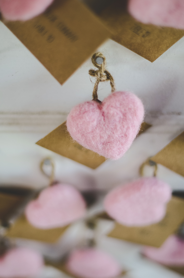 felted pink hearts on escort cards | photo by Jessica Oh Photography #escortcards #pinkhearts