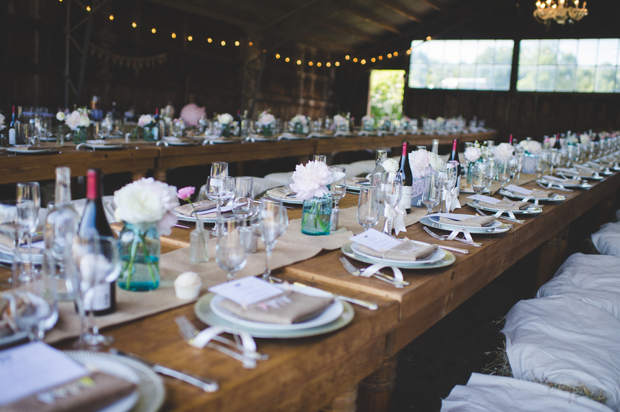 Elegant tablesetting for a barn wedding | photo by Jessica Oh Photography #haybaleseats #longreceptiontables