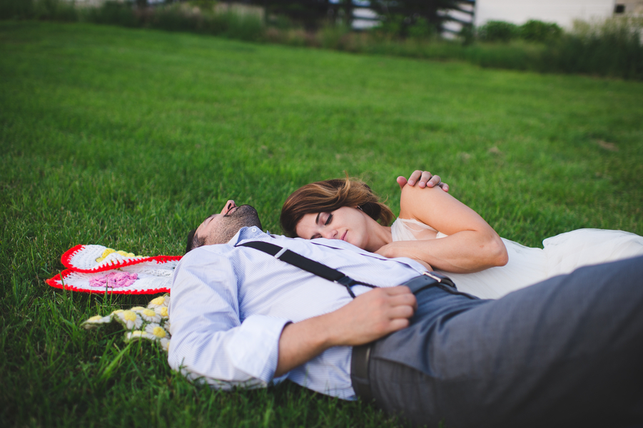 Love this photo of the bride and groom enjoying a quiet moment together in the grass | photo by Jessica Oh Photography