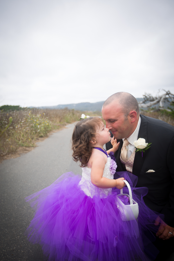 The groom and the cutest flower girl in a purple tutu | photo by Portrait Design by Shanti #flowergirl #purple #tutuflowergirldress #flowergirltutu