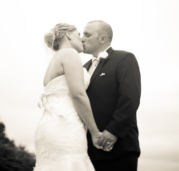 Beautiful black and white photo of the bride and groom kissing | photo by Portrait Design by Shanti