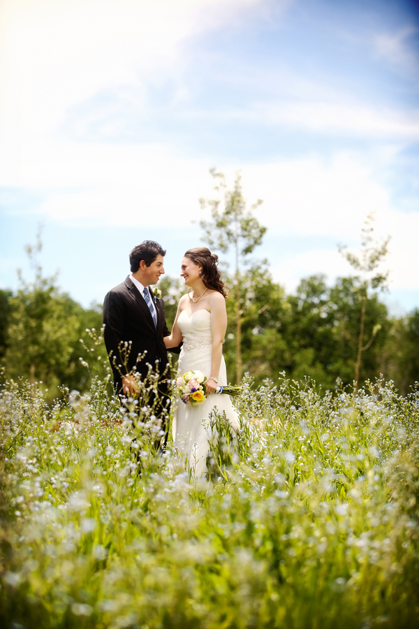 bride and groom portraits in a wildflower field from a Utah wedding | photo by Pepper Nix Photography