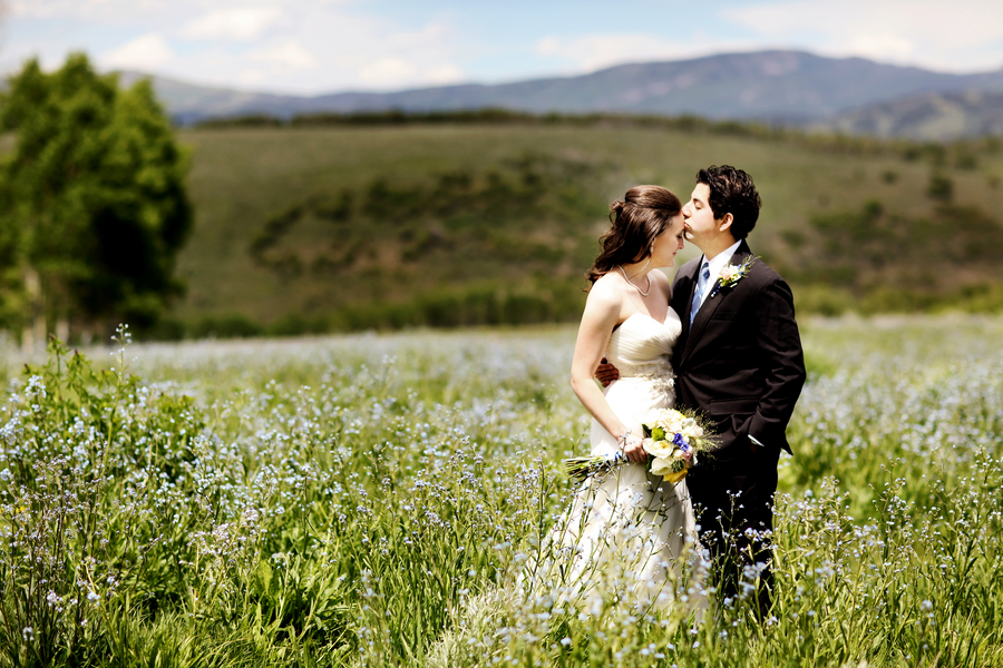 bride and groom portraits in a wildflower field from a Utah wedding with gorgeous scenery | photo by Pepper Nix Photography