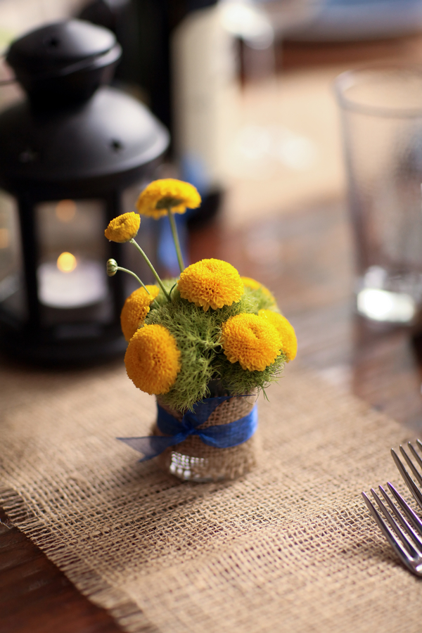 cute little yellow mini floral arrangement wrapped in burlap and tied with blue ribbon | Pepper Nix Photography