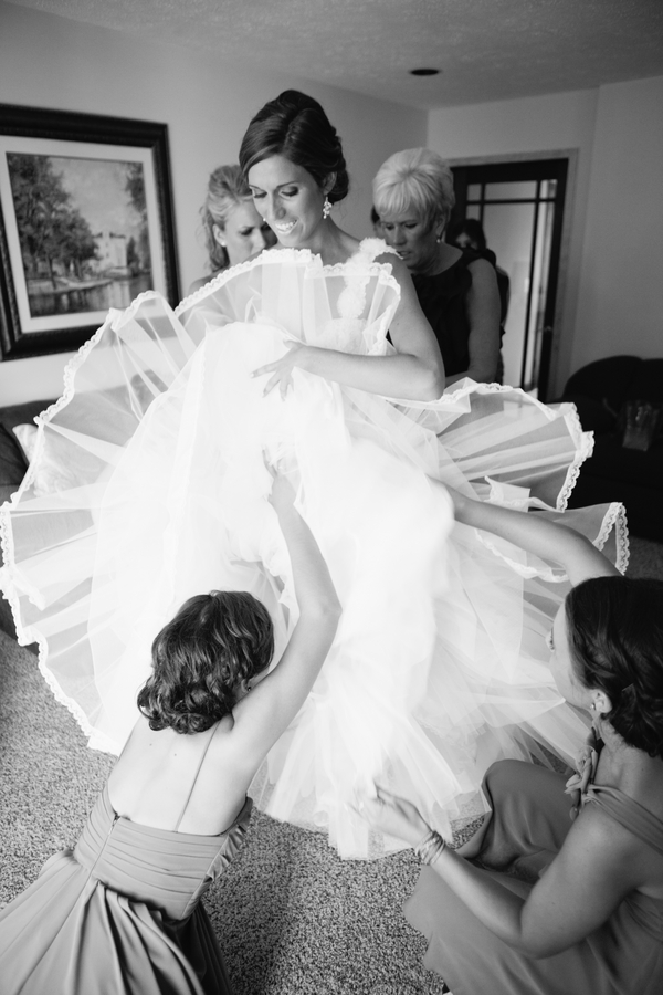 great shot of the bride getting into her wedding gown | photo by Mary Dougherty Photography