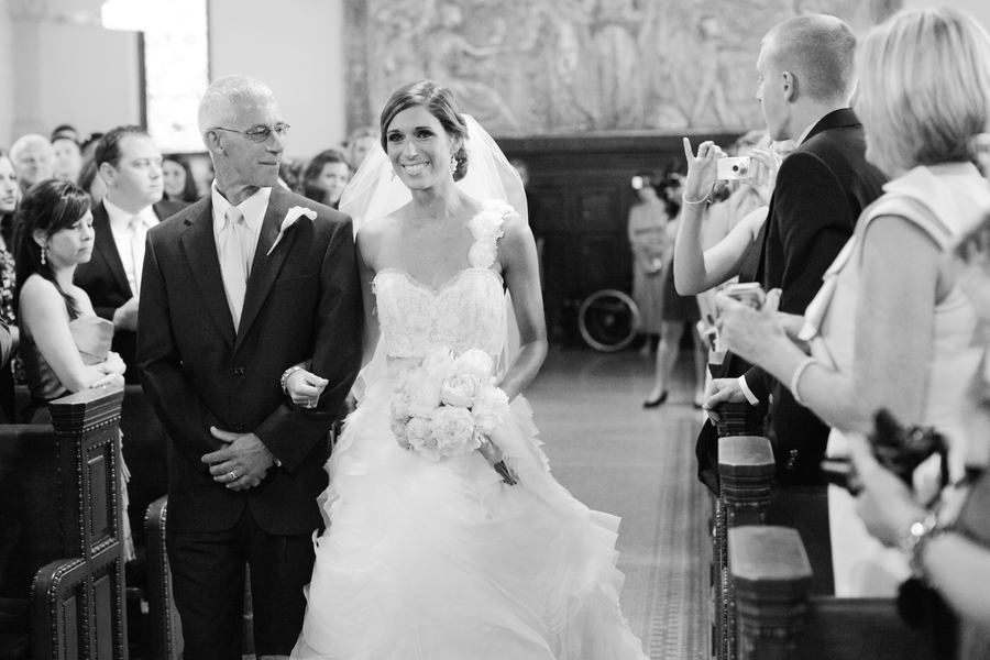 the bride and her dad walking down the aisle | photo by Mary Dougherty Photography