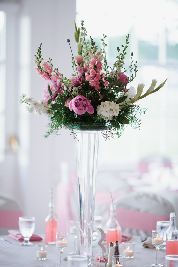 pink and white wedding flower centerpiece on a tall glass vase | photo by Mary Dougherty Photography