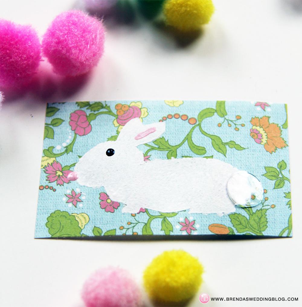 Stamped Bunny Tag DIY Tutorial - using xyron glue dots | DIY on www.brendasweddingblog.com/blogs/2014/4/18/pom-pom-stamped-bunny-tags-a-fun-last-minute-easter-diy