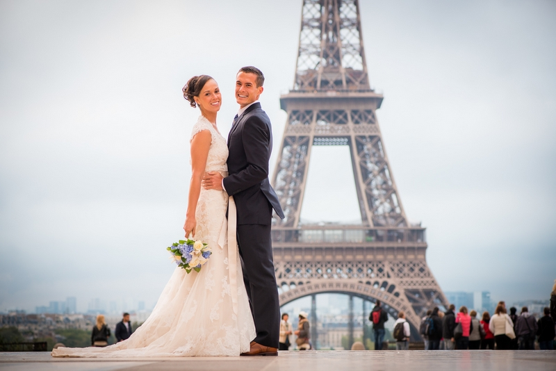 Happy couple that eloped to Paris, France from California in-front of the Eiffel Tower   planned by Paris Weddings by Toni G.   photography by The Paris Photographer