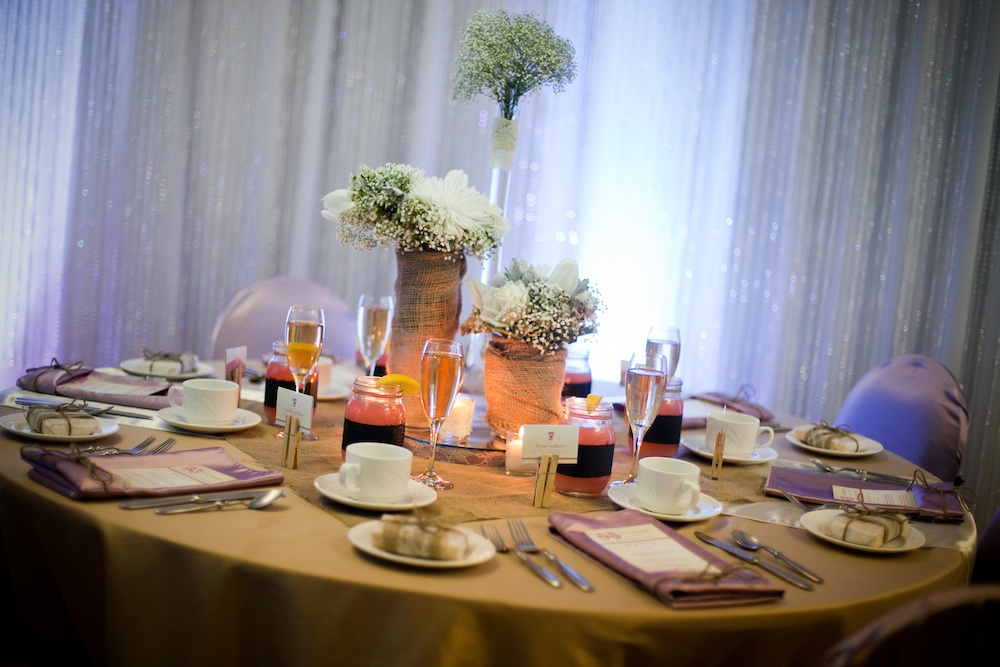 Baby's Breath centerpieces with vases wrapped in burlap from Madeline's Weddings & Events in Canada | via the Wedding Vendors I ♥™ Guide on www.brendasweddingblog.com