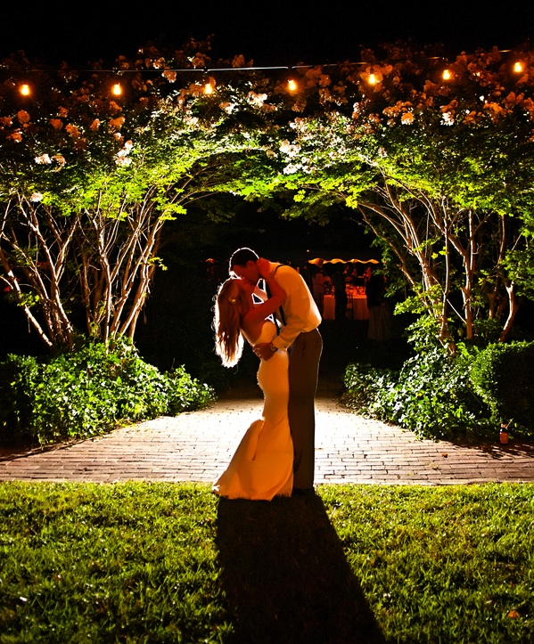 Spectacular night shot of the bride and groom | photo by wwww.EverAfterVisuals.com as seen on www.brendasweddingblog.com