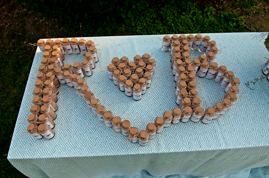 Couples initials created with the favor jars | photo by wwww.EverAfterVisuals.com as seen on www.brendasweddingblog.com