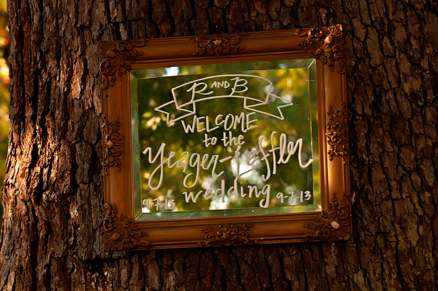 Cute Mirror attached to the tree at the wedding entrance | photo by wwww.EverAfterVisuals.com as seen on www.brendasweddingblog.com