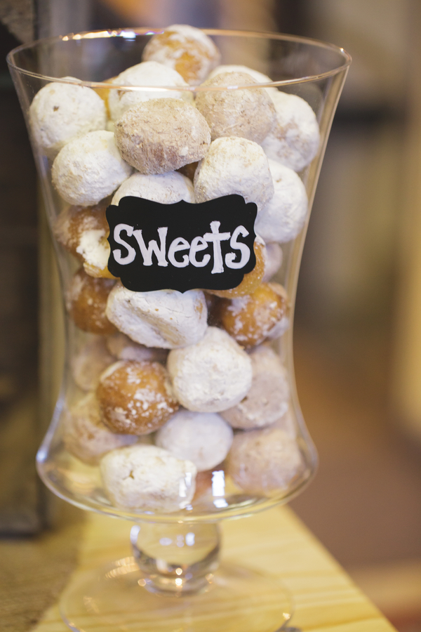 Donut Holes Displayed in a Glass Vase with Chalkboard Sign | as seen on BrendasWeddingBlog.com
