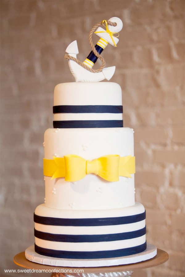 Nautical Wedding Cake with Stripes and a Yellow Bow, Topped with an Anchor | from sweetdreamconfections.com ~ photo by marie-photography.com | seen on BrendasWeddingBlog.com {found via theperfectpalette.com}