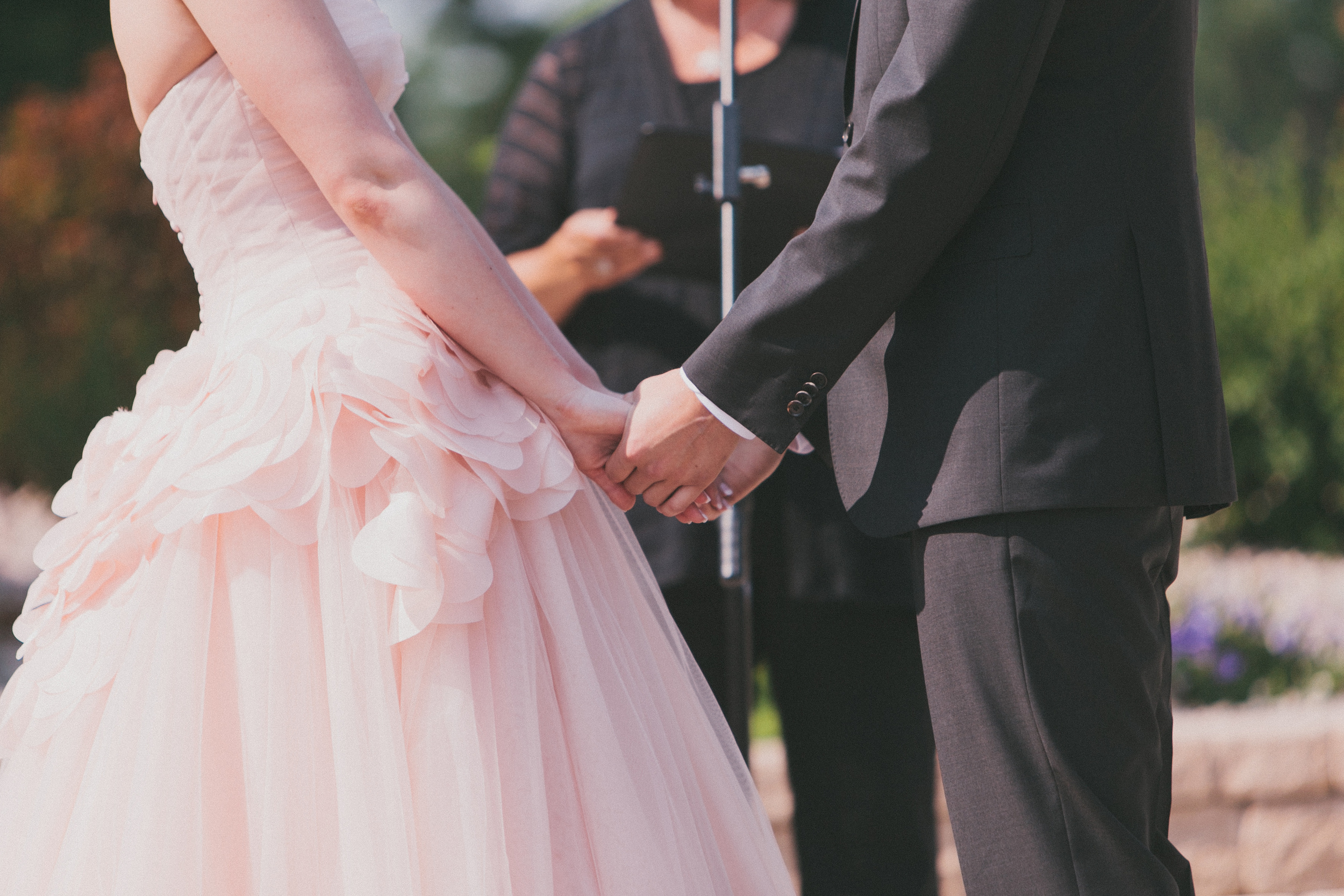 Bride in her Pink Vera Wang Wedding Gown saying her vows | photo by blf Studios | wedding by Madeline's Weddings