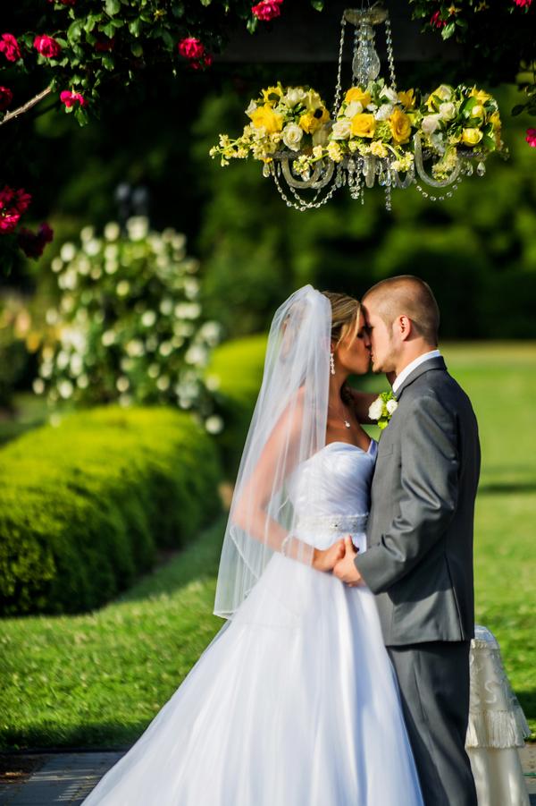 Bride & Groom Married under Chandelier | photo by Ross Costanza Photography | as seen on www.BrendasWeddingBlog.com