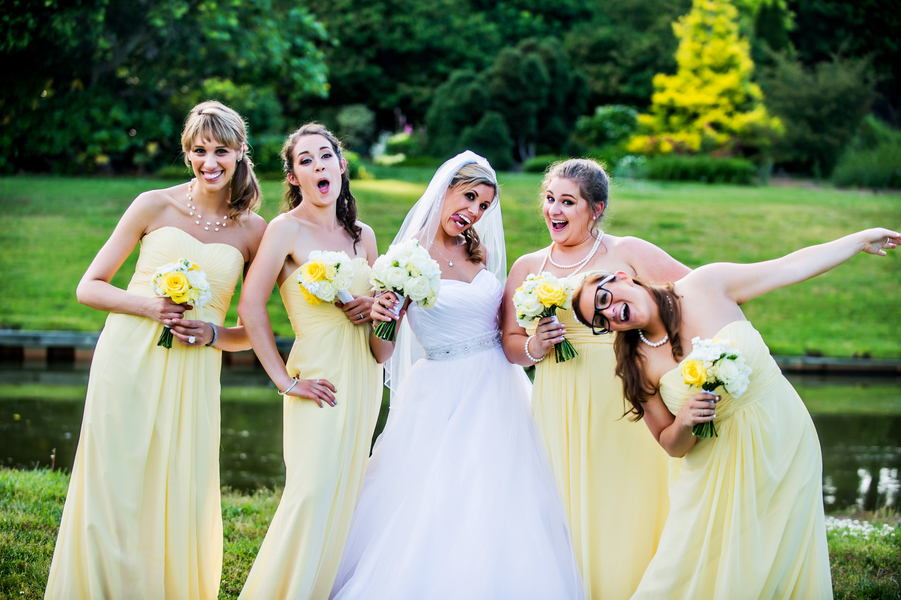 Fun Photo of Bride with her Bridesmaids | photo by Ross Costanza Photography | as seen on www.BrendasWeddingBlog.com