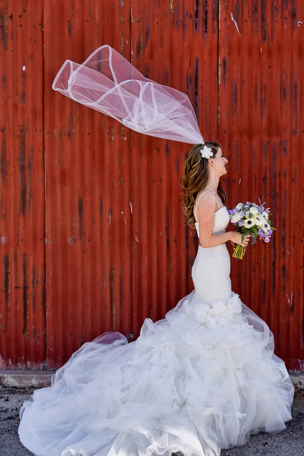 Loving this Bride's Wedding Dress with Tulle Layers | Photo by William Innes Photography | via www.brendasweddingblog.com