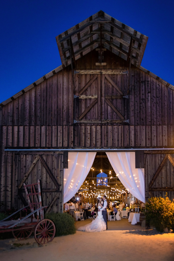 Barn Wedding Reception Entrance at Night | Photo by William Innes Photography | via www.brendasweddingblog.com