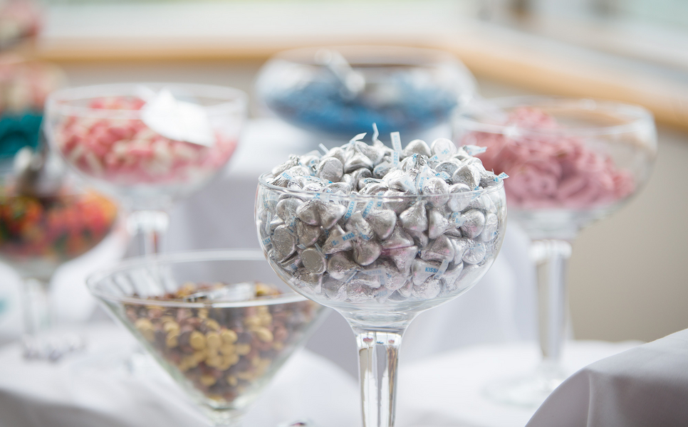 Pretty Silver and Pastel Wedding Candy Table | photo by Real Image Photography | as seen on www.brendasweddingblog.com