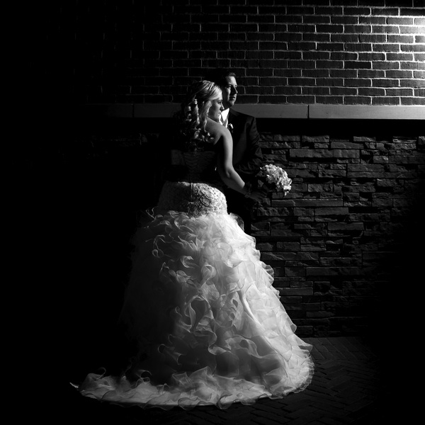 Spectacular Lighting in this Black and White Photo of the Bride and Groom | photo by Real Image Photography | as seen on www.brendasweddingblog.com