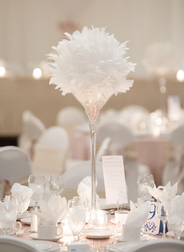Feathers in Tall Glass Vase for Wedding Centerpiece | photo by Real Image Photography | as seen on www.brendasweddingblog.com
