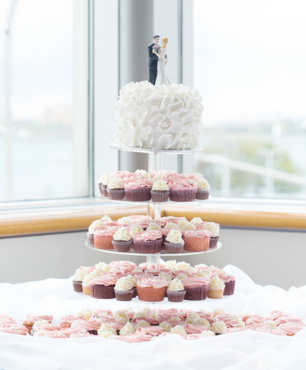 White Ruffled Wedding Cake and Pink and Ivory Cupcakes | photo by Real Image Photography | as seen on www.brendasweddingblog.com