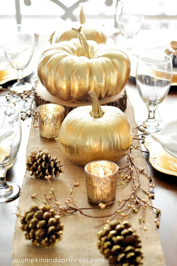 Fall Wedding and Bridal Shower Decorating Idea : Line the Center of the Table with Gold Painted Pumpkins + Pinecones on a Burlap Runner / from A Pumpkin and a Princess / as seen on www.BrendasWeddingBlog.com