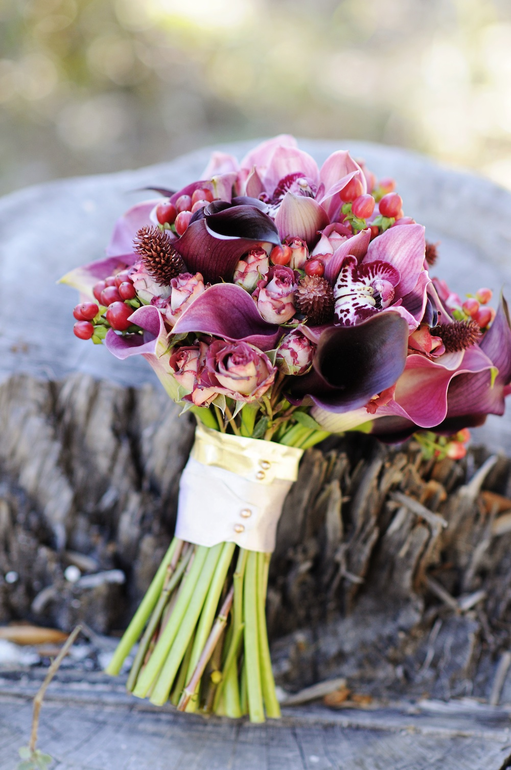Stunning Red and Plum Wedding Bouquet / from a Winter Wedding Inspired Photo Shoot / photo by Kismis Ink Photography / Bouquet by MMD Events / as seen on www.BrendasWeddingBlog.com