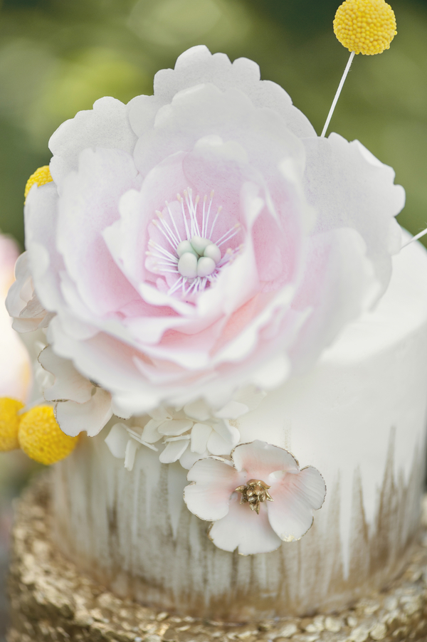 A Spectacular Sugar Flower Topping a Wedding Cake that is completely edible by Kitty Wong Pastry Shop / photo by L'Estelle Photography / as seen on www.BrendasWeddingBlog.com