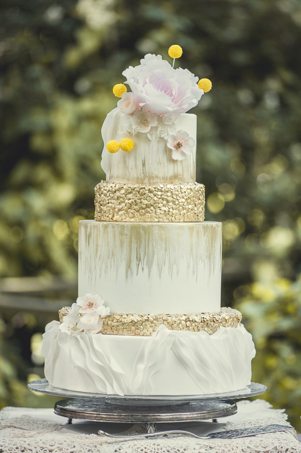 A Pink and Gold Wedding Cake that features exquisite details like ruffles and gold sequins. Painted with white and gold watercolor effects by Kitty Wong Pastry Shop / photo by L'Estelle Photography / as seen on www.BrendasWeddingBlog.com