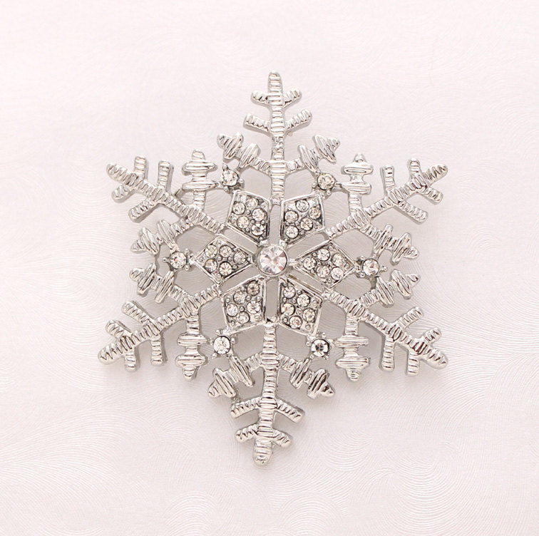 Silver Snowflake Brooch which would make a greatBoutonniere for a Winter Wedding / from Crystalitzy on etsy / as seen on www.brendasweddingblog.com
