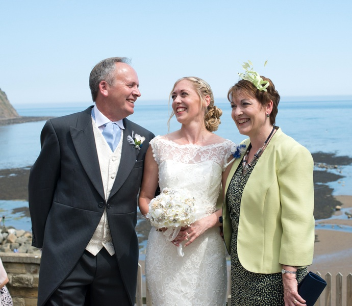The Bride and her Parents at the Seaside Wedding in the UK | photo by Tracey Ann Photography / as seen on www.BrendasWeddingBlog.com