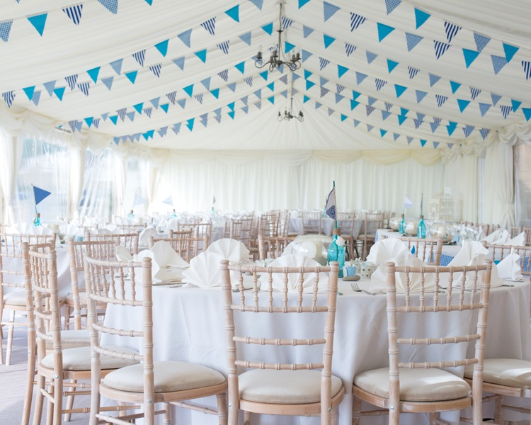 Gorgeous Seaside Wedding Reception in the UK with Handmade Bunting | photo by Tracey Ann Photography / as seen on www.BrendasWeddingBlog.com