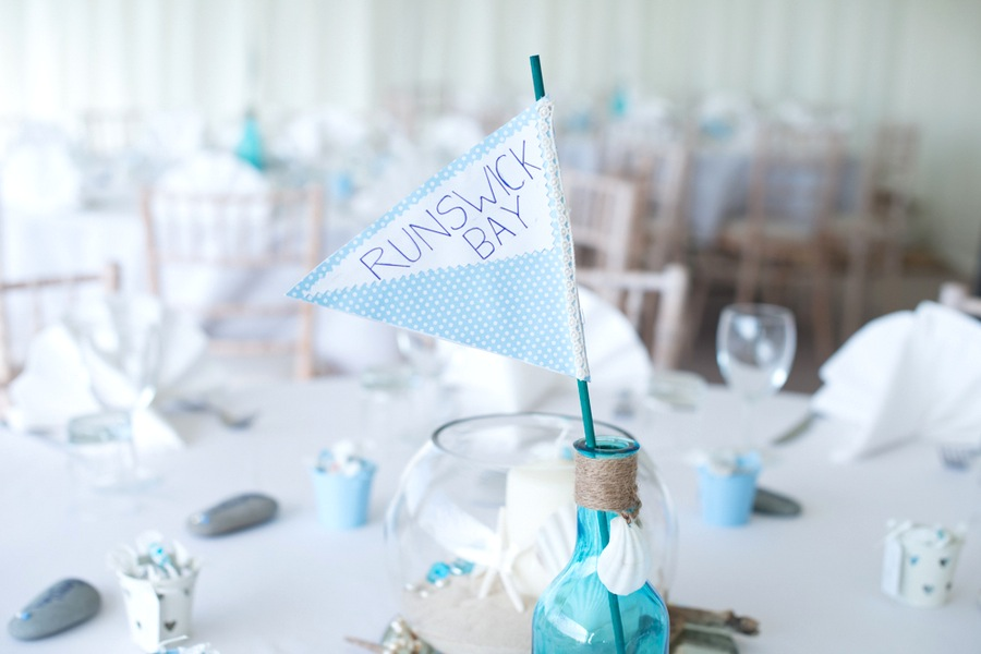 Cute Handmade Fabric Banner Flags for Table Numbers | photo by Tracey Ann Photography / as seen on www.BrendasWeddingBlog.com