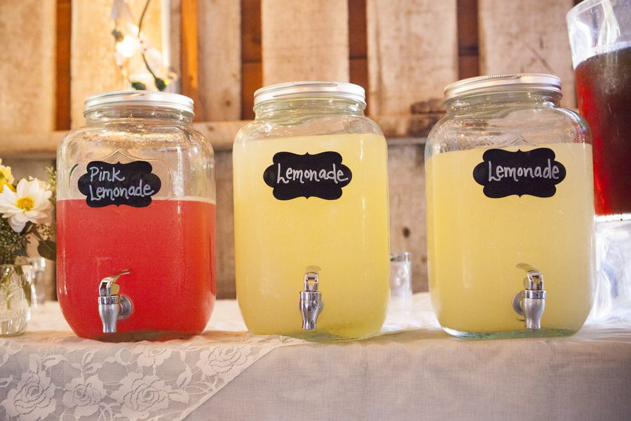 DIY Barn Wedding - large lemonade dispensers - YUM!!! / photo by Town Country Studios / as seen on www.BrendasWeddingBlog.com