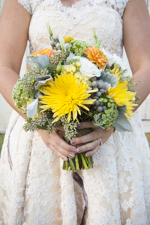 DIY Barn Wedding - orange and yellow rustic wedding bouquet from Flowers by Fluidbloom / photo by Town Country Studios / as seen on www.BrendasWeddingBlog.com