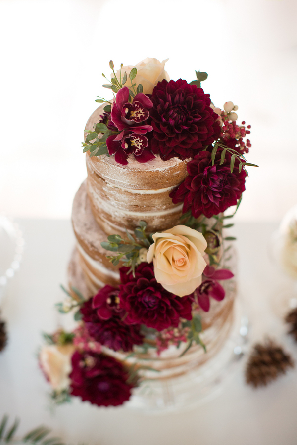 Naked Wedding Cake with Deep Red Flowers by Heavenly Delights Cupcakery / photo by Ashley Cook Photography / as seen on www.BrendasWeddingBlog.com