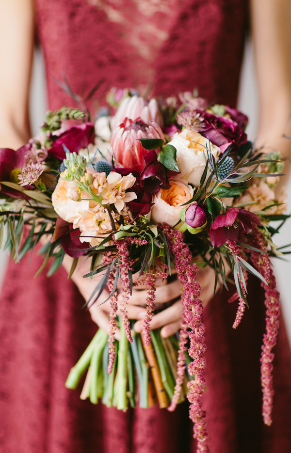 Gorgeous Wedding Bouquet with protea, ranunculus, blue thistle and lotus pods / by Wallflower Designs / photo by Maggie Fortson Photography