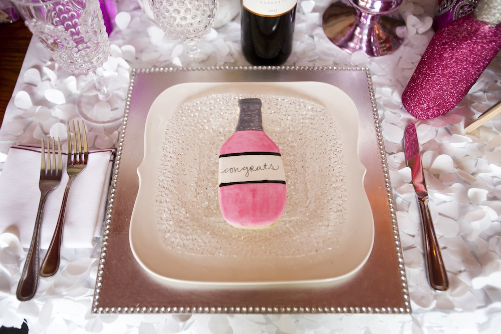Cute Pink Frosted Wine Bottle Sugar Cookie from a Retro Inspired Wedding Shoot / photo by Krista Patton Photography