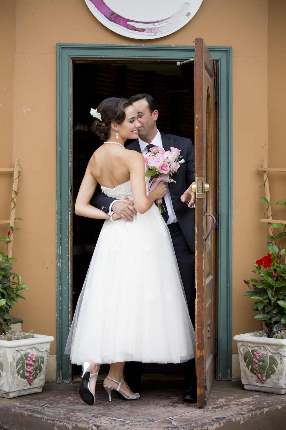 Cute Wedding Photo Idea {sneaking away for a few kisses} / photo by Krista Patton Photography
