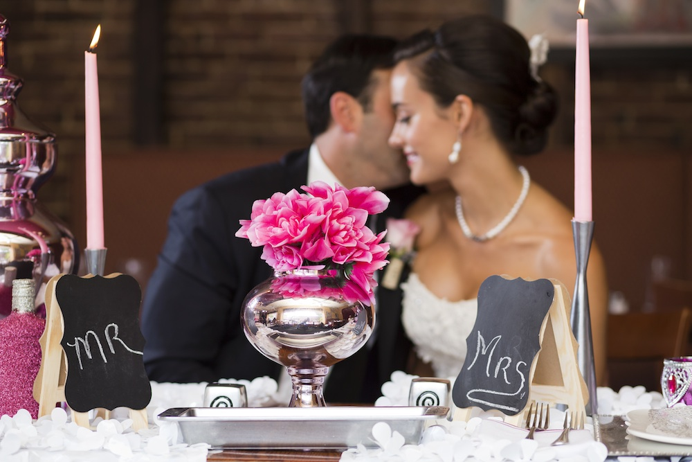 Love the Lush Bright Pink Floral Centerpiece in the Silver Vase / photo by Krista Patton Photography