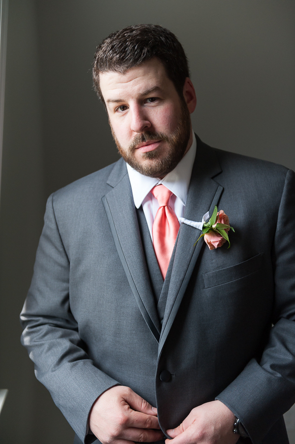 Groom in a Charcoal Suit, Orange Tie and Orange Boutonniere / photo by Havana Photography