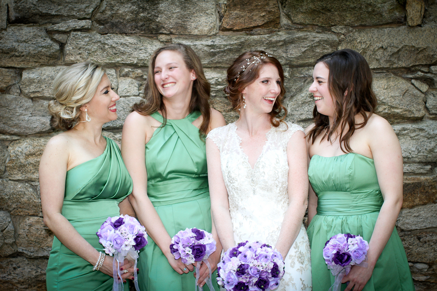 Bridesmaids in Pretty Spring Green Dresses with Purple Rose Bouquets / photo by Crystal Image Photography