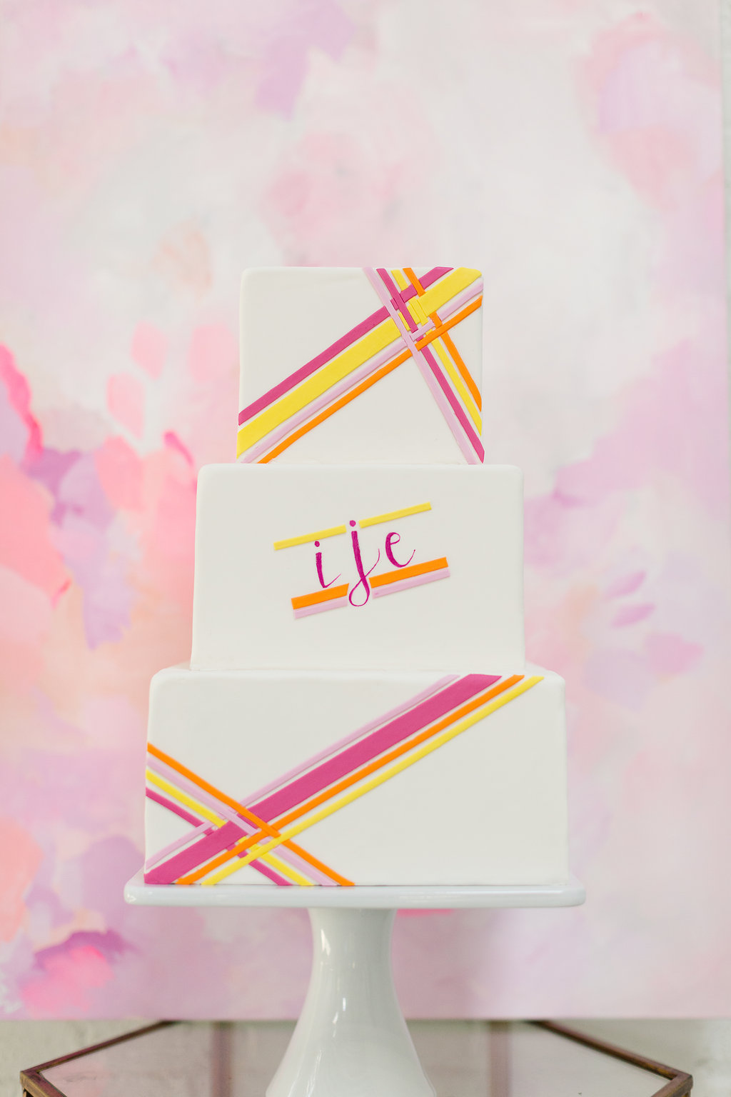 Striped Neon Wedding Cake / designed by Ashley Peraino + Ivey Weddings & Events / Cake by Erica O'Brien Cake Design / photo by Jessica Haley Photography