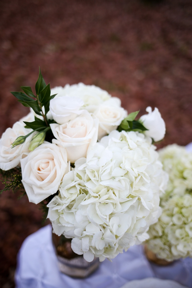 Gorgeous White Hydrangea and Rose Centerpiece by EightTreeStreet / photo by Debbie Ringle Photography